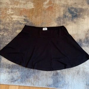 Cute AE black knit mini Sz LG, in good cond.
